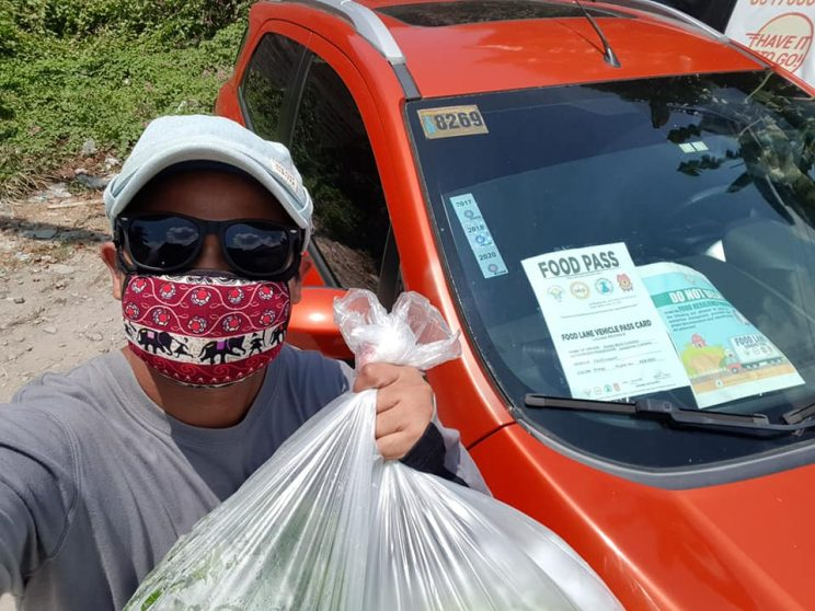 The Agrillenial in action. delivering goods amid the pandemic 744x558 - Prolific millennial farmer finds further success in inspiring viewers on social media, Part 1: from farmer to agriculture influencer